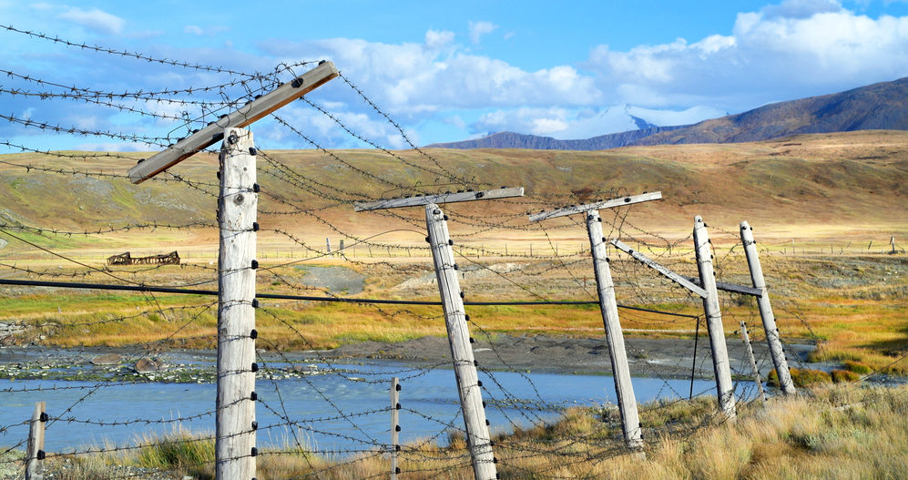 barbed wire fence crossing a landscape