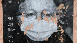 graffiti of Joseph Brodsky wearing a medical paper face mask over his mouth and nose