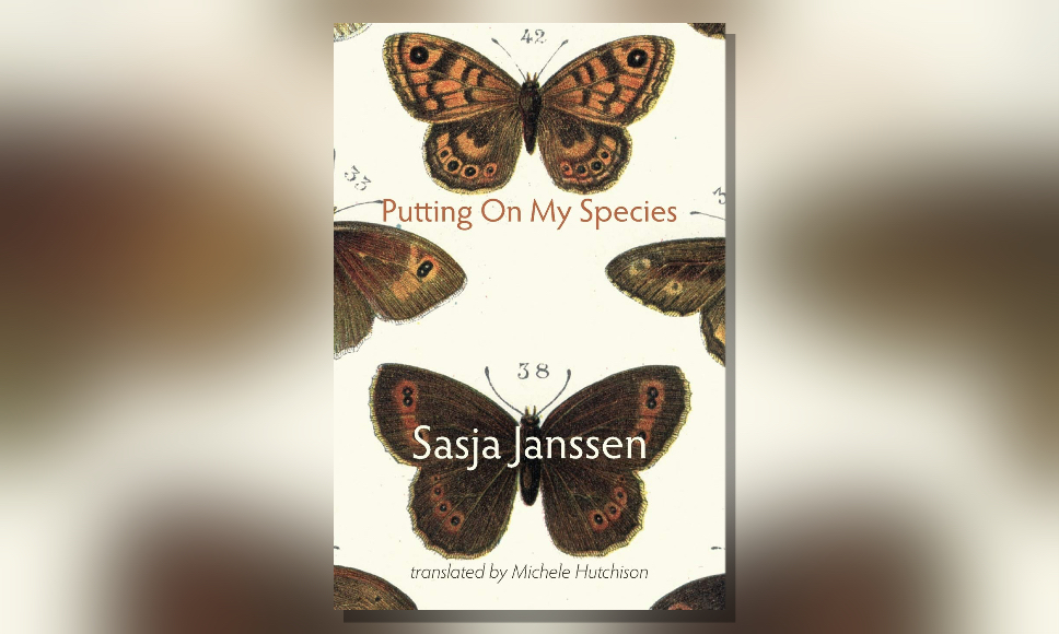 "a book with butterflies on the cover - titled ""Putting On My Species"", by Sasja Janssen"